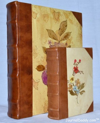 Italian photo album with leather spine and corners and dried flowers on cover